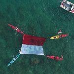 Indopos.co.id : Tanjung Lesung Helat Pengibaran Bendera HUT RI ke-74 di Darat-Laut-Udara